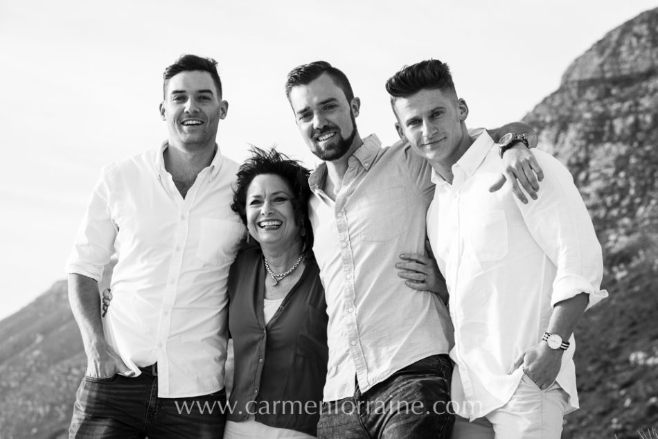 mom and sons on the beach