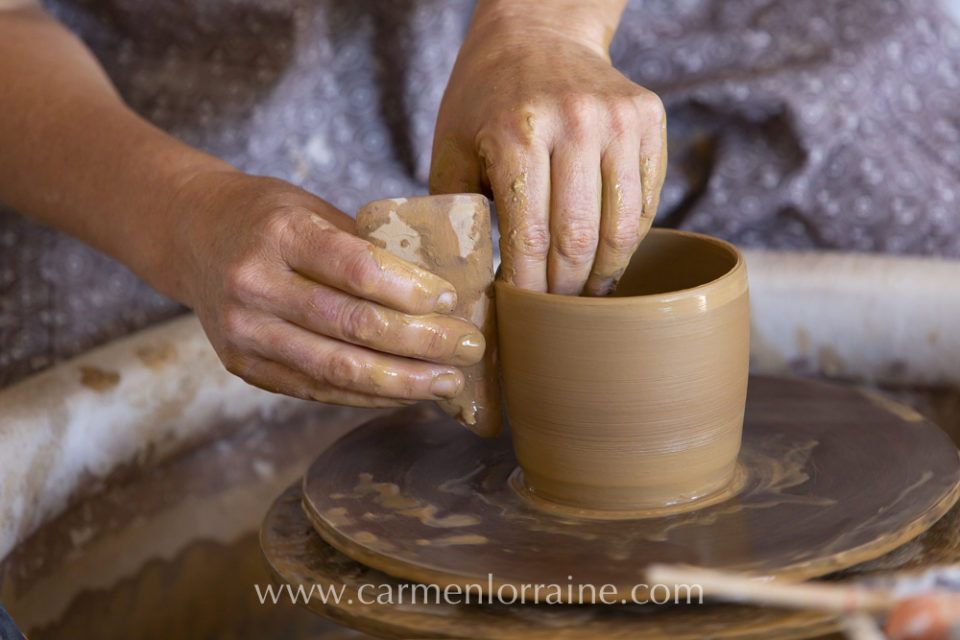 shaping clay on the wheel