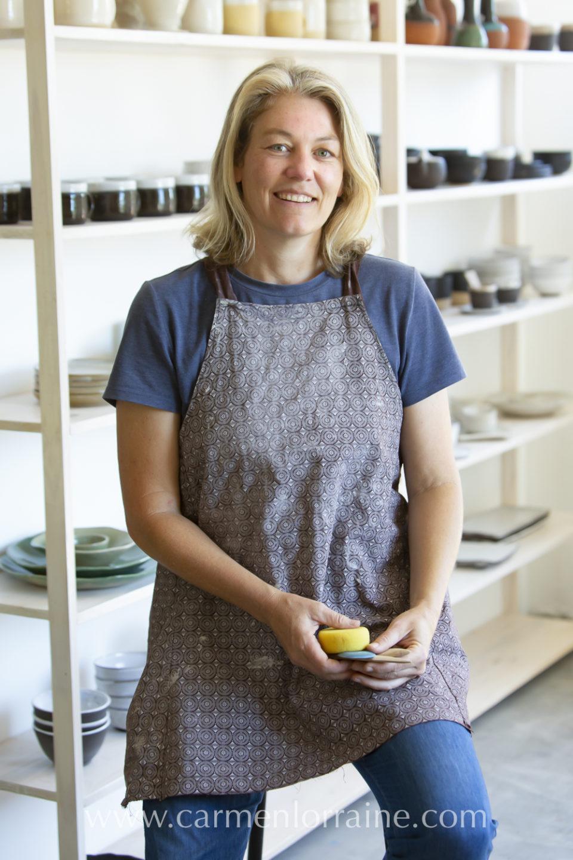 a ceramic artist in her studio